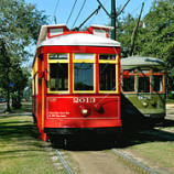 250px-Streetcars_on_St_Charles_Ave_Red_Green