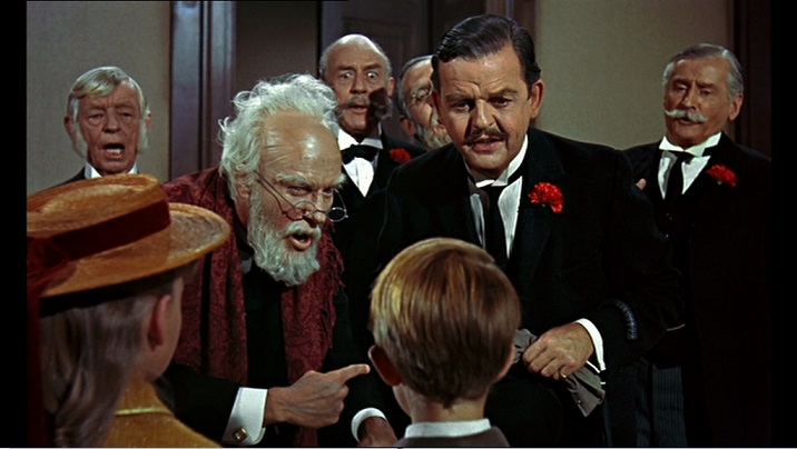 Mister Dawes Padre (Dick Van Dyke), Mr. Dawes figlio (Arthur Malet) e Mr. George Banks (David Tomlinson) nel film Mary Poppins del 1964.