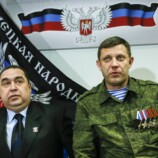 Zakharchenko, leader of the self-proclaimed DPR, and Plotnitsky, leader of the self-proclaimed LPR, attend a news conference in Donetsk