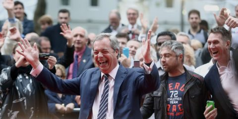 "Nigel Farage, leader of the U.K. Independence Party (UKIP), cheers with the crowd as he arrives for the premiere of ""Brexit: The Movie"" in London, U.K., on Wednesday, May 11, 2016. While online polls suggest the contest for the June 23 referendum is too close to call, less frequent telephone polling has put the ""Remain"" camp ahead. Photographer: Chris Ratcliffe/Bloomberg via Getty Images"
