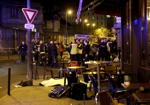 ATTENTION EDITORS - VISUAL COVERAGE OF SCENES OF INJURY OR DEATH A general view of the scene that shows rescue services near the covered bodies outside a restaurant following a shooting incident in Paris, France, November 13, 2015. REUTERS/Philippe Wojazer