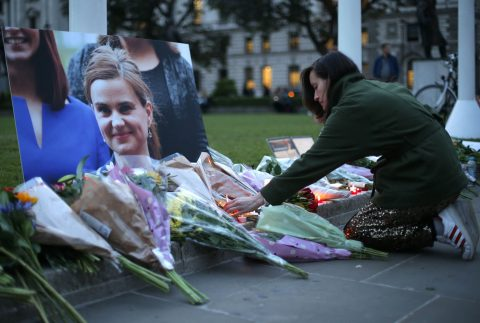 Floral tributes and candles are placed by a picture of slain Labour MP Jo Cox at a vigil in Parliament square in London on June 16, 2016. Cox died today after a shock daylight street attack, throwing campaigning for the referendum on Britain's membership of the European Union into disarray just a week before the crucial vote. / AFP / DANIEL LEAL-OLIVAS (Photo credit should read DANIEL LEAL-OLIVAS/AFP/Getty Images)