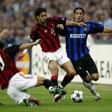 Rui Costa and Alessandro Costacurta of AC Milan and Francesco Coco of Inter Milan